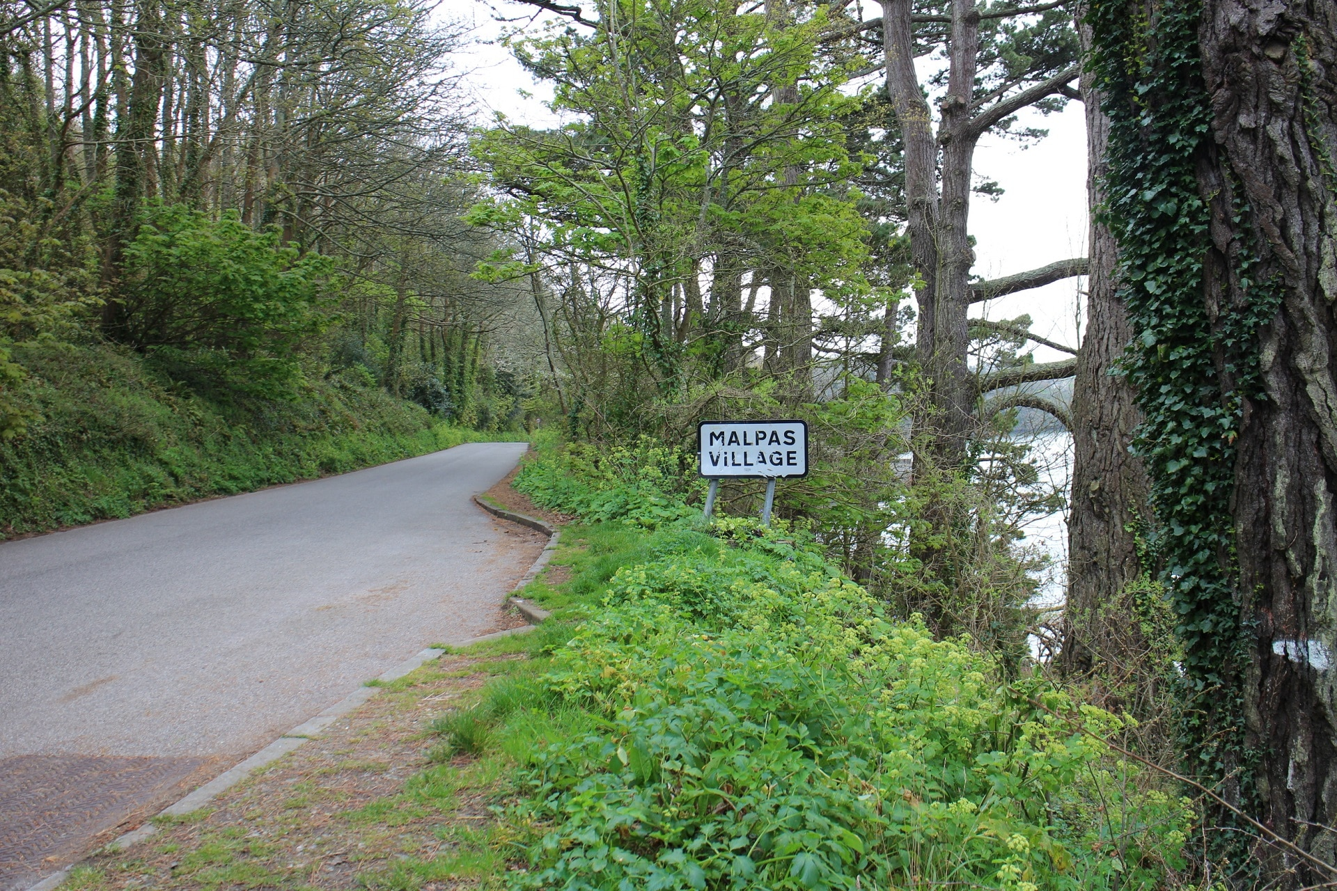 Sign on the road showing the boundary of Malpas village